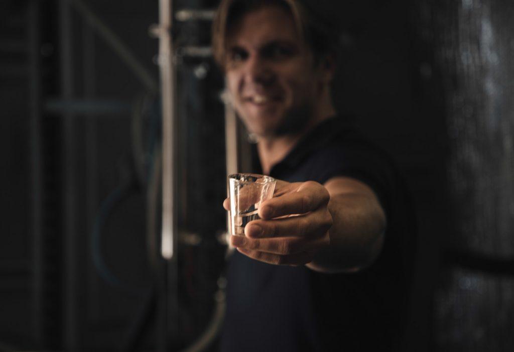 A friendly distiller offers a sip of award-winning craft spirits